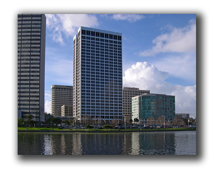 group of buildings across lake merritt