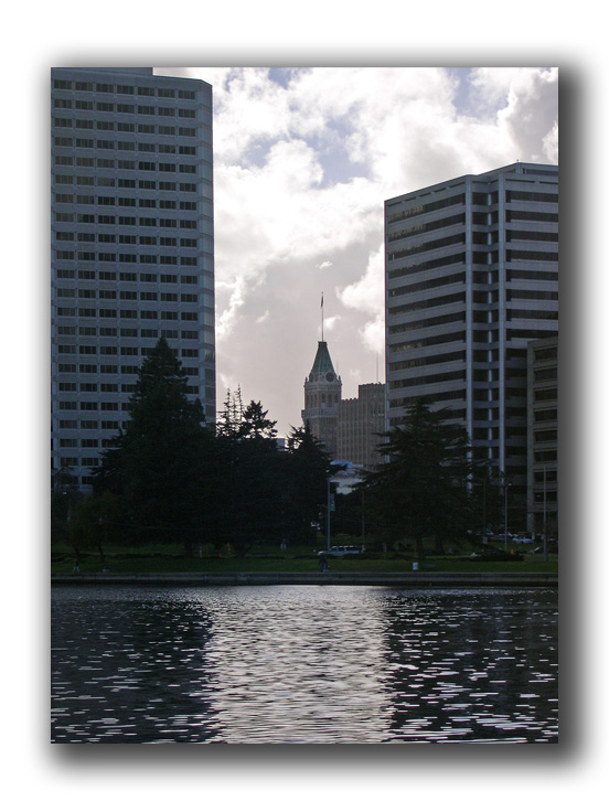 city hall clock tower from lake merritt